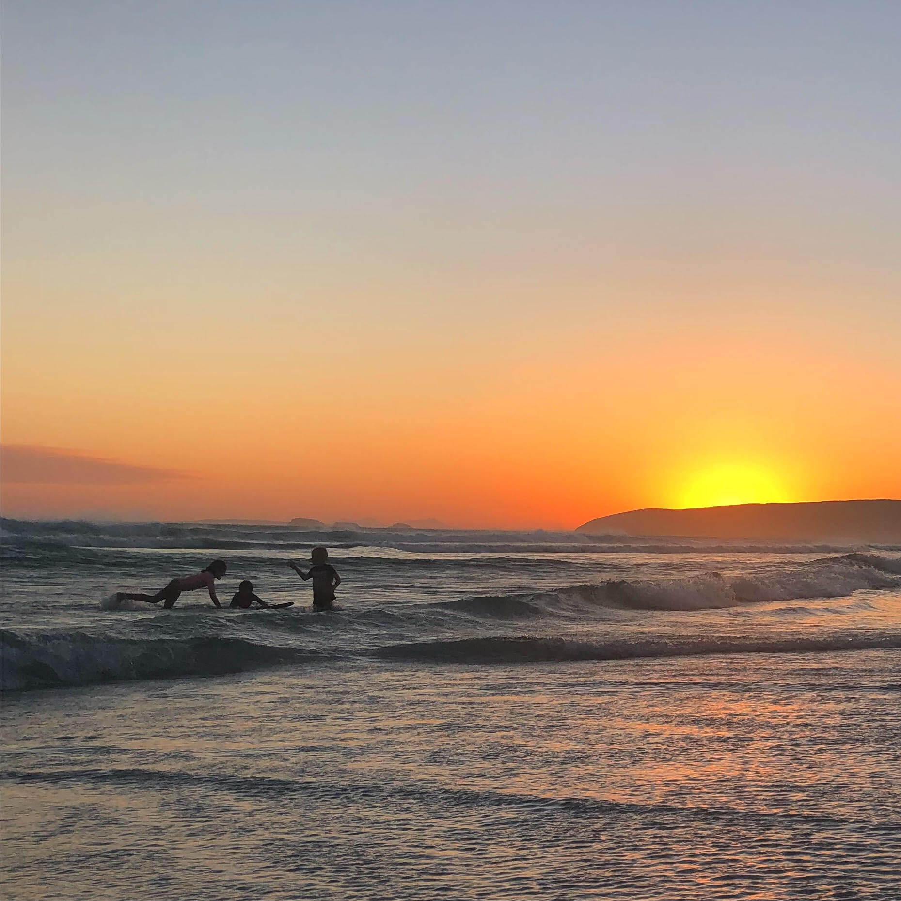 Kids having fun in the surf at Foster Beach, Bremer Bay - Credit: Alice Reddington Photography