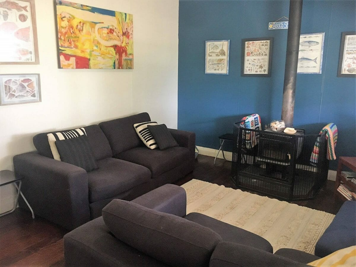 Weekender - Accommodation in Bremer Bay - 21 Barbara Street. Loungeroom has 3 seater and 2 seater couches, TV, DVD and fireplace